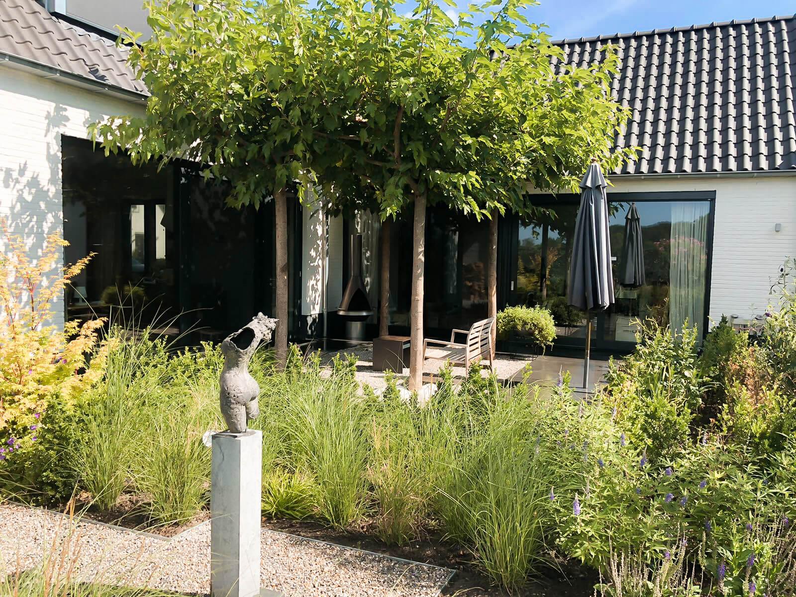 Aanleg luxe achtertuin nieuwbouw Brandevoort